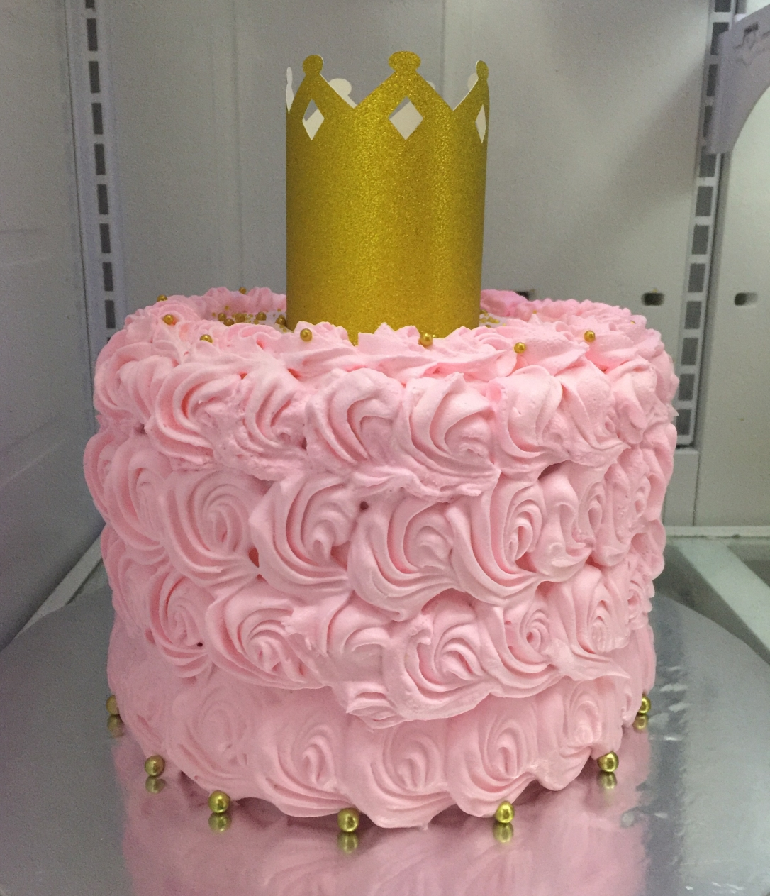 """Gold Crown"" Pink Rosettes Cake"